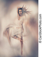 Fine art photo of woman in white dress