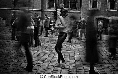 Fine art photo - topless brunette startled in the street...