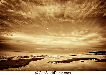 Fine art picture of sea, ocean at sunset. Dramatic sky.