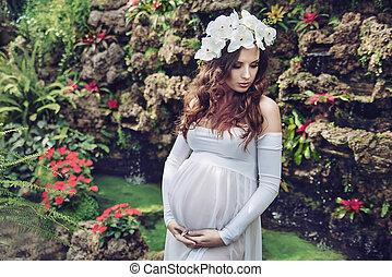 Fine art portrait of a pregnant woman