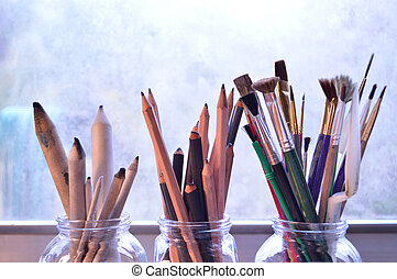 Fine art supplies: Three bouquets of drawing and painting tools.
