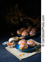 Fine Berlin donuts with jam filling and icing