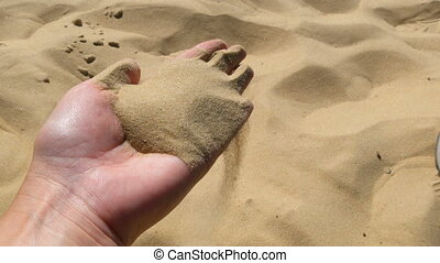 Fine crumbly sand of the ancient Sarmatian Sea in female hands.