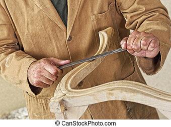 carpenter at work - fine detail of caucasian carpenter at...