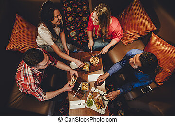 Fine Dining Friends - Overhead view of a group of friends...