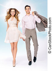 Fine picture of walkinng young couple