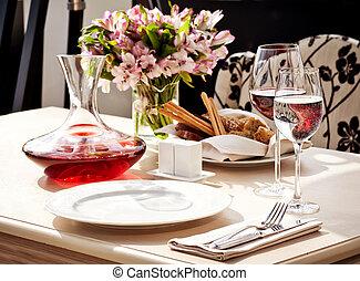 Fine restaurant dinner table place setting: napkin,...