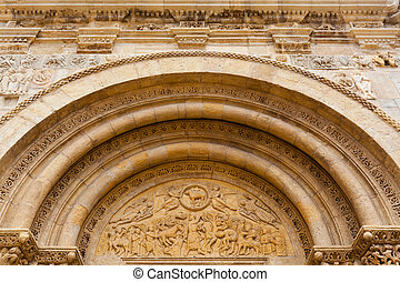 Fine romanesque  archivolts and tympanum in San isidoro Leon