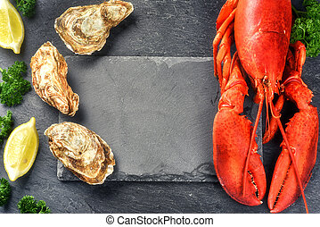 Steamed lobster and oysters on dark background