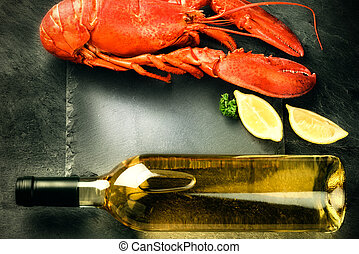 Fine selection of crustacean for dinner. Steamed lobster with bottle of white wine
