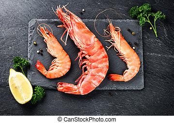 Fine selection of jumbo shrimps for dinner on stone plate