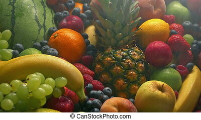 Fine Spray Keeps Fruit Pile Fresh - Moving over a large...