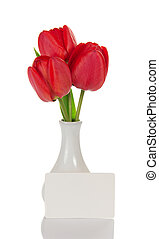 Fine tulips in a vase and the empty card