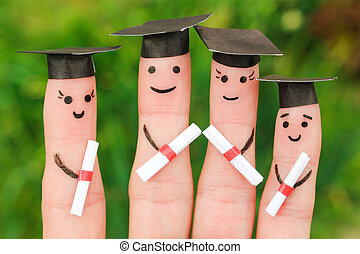 Finger art of students. Graduates holding their diploma after graduation
