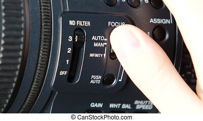 Finger changes video switcher on digital camera, focus infitity