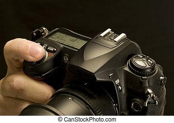 Finger Depressing Camera Shutter Bu
