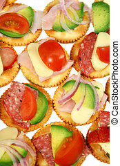 Finger food of cracker biscuits with various toppings.