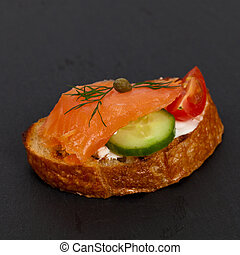 Finger food canape with smoked salmon
