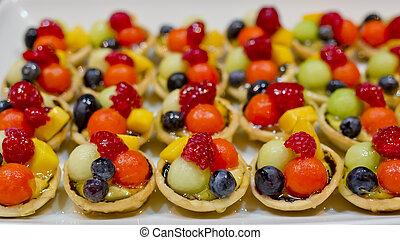 finger food, dessert and fruits cocktail