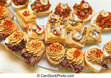 Finger food - Large assortment of canapes served on cocktail...