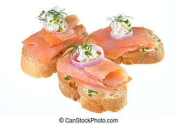 Baguette with smoked salmon, seasoned with dill, chives and onion rings