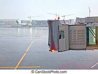 finger for aircraft in frankfurt in heavy rain waiting for...