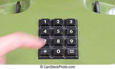 finger landline phone - Closeup cropped shot of human finger...