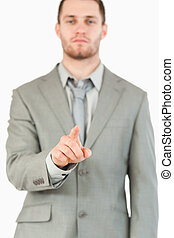Finger of businessman pointing