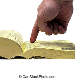 Finger of Hand Pointing at Yellow Pages Book