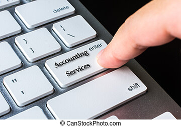 Finger on computer keyboard keys with Accounting Services word