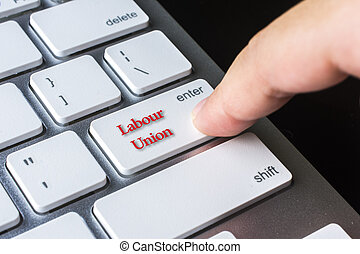 Finger on computer keyboard keys with Labour Union word