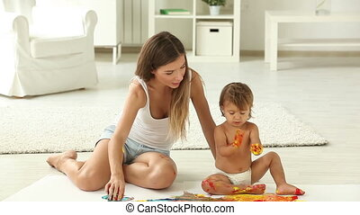 Finger-painting - Lovely mom and daughter being occupied...