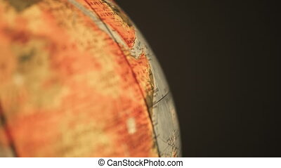 Finger pointing on earth globe - Looking for something and...