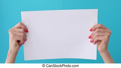 finger points on blank sheet of paper in female hand...