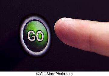 Finger presses green GO button on touchscreen