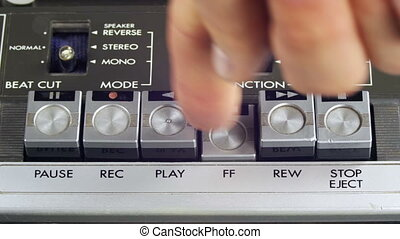 Finger Presses Play, Stop, Forward, Rewind, Pause and Record...