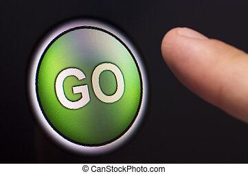 Finger pressing a green GO button on touchscreen