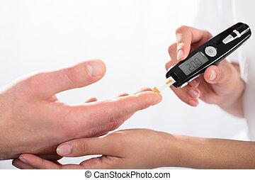 Finger Prick For Glucose Sugar Measuring Level Blood Test