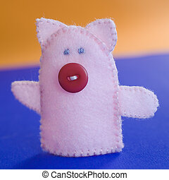 Finger puppet (farm animal: pig) on the table