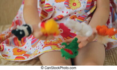 Finger puppets on child's hands