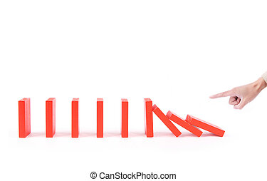 finger pushing dominoes causing chain reaction