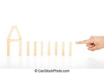 Finger ready to push dominoes in a row