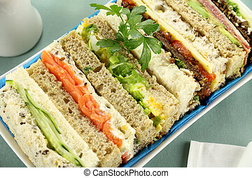 Freshly prepared assorted sandwiches cut without crusts.