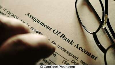 Finger tapping on assignment of bank account