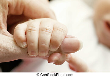 Finger - The baby holding parents finger