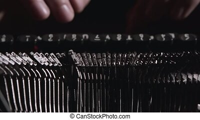 Finger typing on vintage typewriter