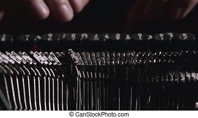 Finger typing on vintage typewriter - Fingers on the keys...