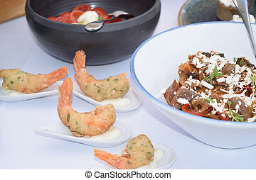 fingerfood of prawns breaded in single portions