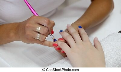 Finger nail treatment, painting with brush and lacquer