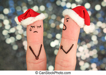 Fingers art of couple celebrates Christmas. Concept of man and woman during quarrel in New Year.